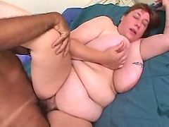 Depraved fatty mom plays with dildo