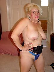 Horny busty granny shows off her great body