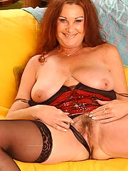 Plump GILF strips off her clothes and play with her massive sagged tits and wet muff
