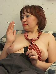 Plump brunette granny slowly stripping off her clothes to unleash her massive sagged breasts