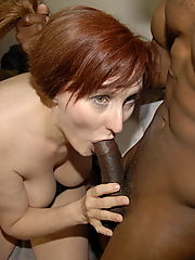 This red mature slut loves the taste of a black cock