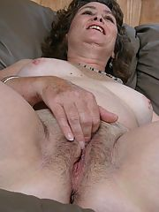 Hot grandma feeling horny and playing with her wet bush in the living room