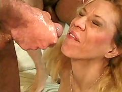 Busty mature sucks n gets titsfuck