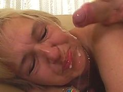 This mama gets a face full of cum