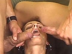 Mature slut taking two cocks at once