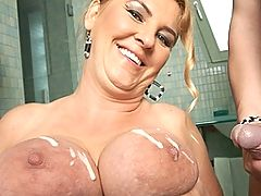 Big titted mama getting nasty on the toilet