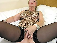 Horny mature slut fingering herself