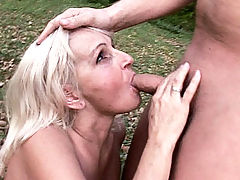Blonde mature babe Mandy gets down on all fours outdoors to have her grandma pussy drilled