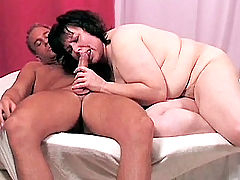 Horny Granny dildo fucking while sucking cock