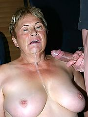 Big tit plump grandma sucking a huge cock and letting cum drizzle all over her face and tits
