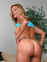 Tanned blonde granny bending over to show off her sexy tanned backside