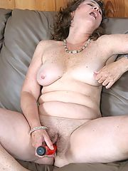 Horny granny takes out her favorite red dildo and plays with her wet pussy
