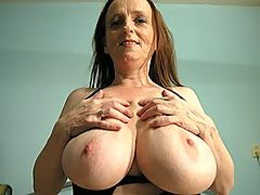 Big titted mature nympho playing with herself