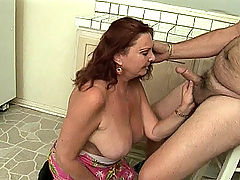 GILF babe getting her mouth wet with jizz
